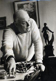 Black and white photograph of Jean Renoir in his mid 60s