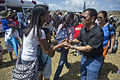 Jejomar Binay, right, the vice president of the Philippines, shakes hands with residents waiting to receive humanitarian aid during Operation Damayan in Guiuan, Philippines, Nov. 16, 2013 131116-N-TE278-355.jpg