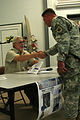 John J. McGinty shaking hands with a soldier in Al Asad, Iraq.jpg