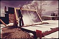 John Keyes, president of International Solarthermics Corporation, shown with the backyard solar heating system he developed..., 05-1975. (6919952738).jpg