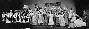 "Allegro (musical) - ""Joseph Taylor, Jr."": the townsfolk assemble to celebrate Joe's birth.  From the original Broadway production; William Ching as Dr. Taylor, with Muriel O'Malley as Grandma and Annamary Dickey as Marjorie (in bed), all at right."