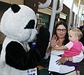 June 2013 - High-fiving Pandy Pollution, EPA's mascot (9730409211).jpg