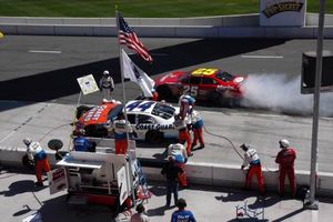 Mike McLaughlin - McLaughlin smokes his tires while leaving the pits in his No. 25 car during the 2004 California race.