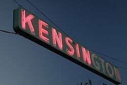 A neon sign hangs over Adams Avenue, the main thoroughfare in Kensington.