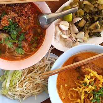 Suan cai - Two styles of khao soi. Pickled cabbage is used as a condiment with the curry version of khao soi.