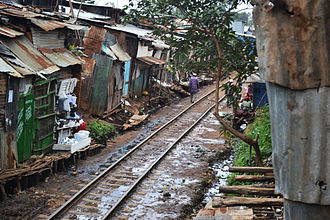 Kibera - Railway Tracks in Kibera, Nairobi, Kenya. The Uganda Railway line linking Mombasa, Nairobi and Kisumu on Lake Victoria began about 1901 under the British colonial empire. In the early 20th century, the British government gave Kenyan soldiers in its regional army the right to live on public land near the railway tracks, leading to the creation of Kibera.