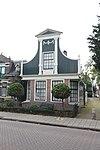 foto van Grotendeels houten huis