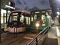 Kumamoto City Tramcars at Shin-Suizenji Station.jpg