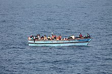 A boat with migrants, off the Libyan coast.