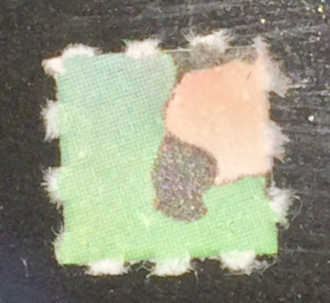 History of lysergic acid diethylamide - LSD crystals visible on a green blotter, up close.