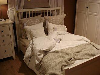 Duvet - A bed with a duvet
