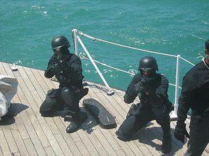 Pasukan Gerakan Khas - UTK operators practice storming a ship during a PGK exercise.