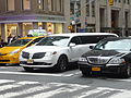 Lincoln Town Car (Old and New) (15133772494).jpg