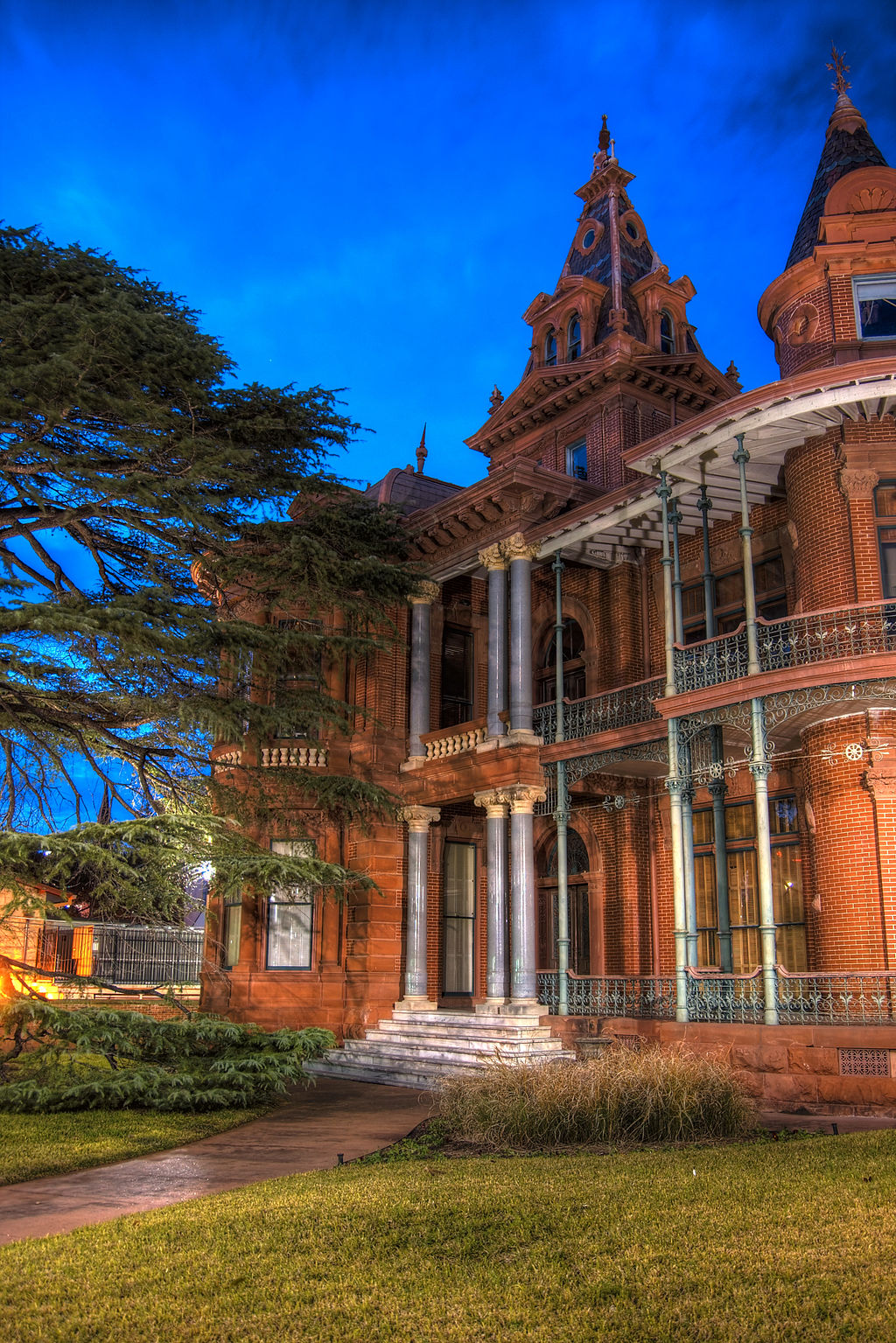 exterior of austin littlefield house at night, one of the most haunted places in austin texas