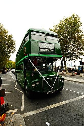 Double-decker bus - London heritage double-decker wedding special bus on the Victoria Embankment