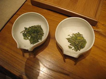 Longjing tea, also known as Dragon Well tea, is a variety of roasted green tea from Hangzhou, Zhejiang Province, China, where it is produced mostly by hand and has been renowned for its high quality, earning the China Famous Tea title.