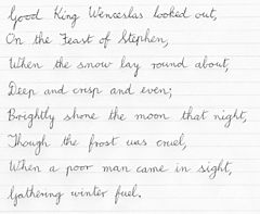 "The first verse of ""Good King Wenceslas"" in cursive"