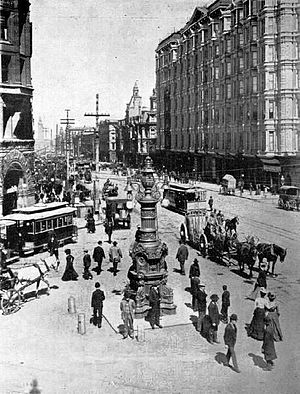 Lotta's Fountain - Lotta's Fountain in 1905, looking east along Market Street, the San Francisco Ferry Building's clock tower in the distance.