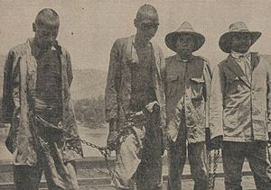 Forrest River massacre: Investigations and Royal Commission -  Lumbia (on left) following his arrest for the murder of Fred Hay in 1926. On the right, two Aboriginal trackers