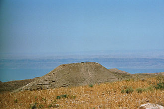 Machaerus - Panoramic view of Machaerus with the Dead Sea in the background.
