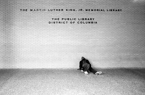Man sitting at MLK Jr. Memorial Library.jpg