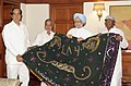 Manmohan Singh handing over the 'Chaadar' to be offered at the dargah of Khwaja Moinuddin Chishti, Ajmer Sharif to the Minister of State for Personnel, Public Grievances & Pensions and Prime Minister's Office (1).jpg