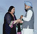 Manmohan Singh presenting the NDTV Indian of the Year award to Late Shri Yash Chopra, the award received by his wife Smt. Pamela Chopra, at the 'NDTV Indian of the Year Awards Function', in New Delhi on April 15, 2013.jpg