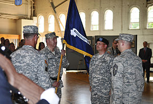 Massachusetts State Defense Force - Brig. Gen. (Ret.) Gary Pappas, Commander, Massachusetts State Defense Force, holds his commands colors during the Massachusetts State Defense Force's activation ceremony at the Massachusetts National Guard Museum and Archives.