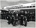 Mayor John F. Collins with unidentified officers in front of Pan American plane (10926232836).jpg