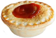 A typical Australian meat pie with tomato sauce (ketchup)
