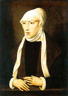 retrato de uma mulher magra com roupas marrons e uma cobertura bronzeada