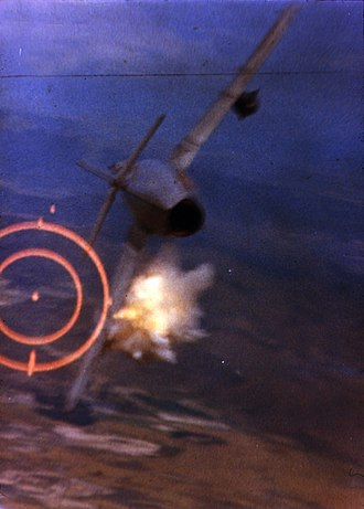 Dogfight - A USAF F-105D shoots down a North Vietnamese MiG-17 during the Vietnam War, June 1967.
