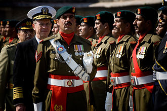Pakistan Armed Forces - American Chairman of Joint Chiefs Admiral Mike Mullen reviews Pakistani troops during a ceremony honouring Mullen's arrival in Islamabad in 2008.