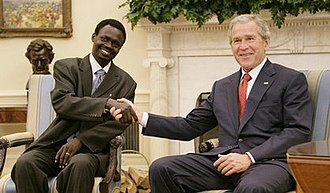 War in Darfur - Minni Minnawi with U.S. President George W. Bush after he signed the May agreement.