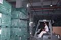 Miyahira Takayuki, a mobility-readiness forklift operator with the 18th Logistics Readiness Squadron, conducts an annual inventory of chemical-warfare defense equipment at Kadena Air Base, Japan, May 23, 2006 060523-F-QO805-006.jpg
