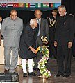 Mohd. Hamid Ansari lighting the lamp to inaugurate the International Relations Conference on 'India and Development Partnerships in Asia and Africa Towards A New Paradigm', in Pune. The Governor of Maharashtra.jpg