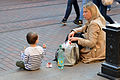 Mother and child sitting on the pavement.jpg