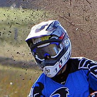 Helmet - A motocross helmet showing the elongated visor and chin bar
