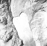Muir Glacier, tidewater glacier terminus with icebergs and calving debris in the water, August 22, 1965 (GLACIERS 5686).jpg