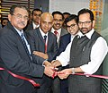 Mukhtar Abbas Naqvi inaugurating the Muthoot HomeFin corporate office, in Mumbai. The Chairman, Muthoot Group, Shri M.G. George Muthoot and the MD, Muthoot Group, Shri George Alexander Muthoot are also seen.jpg