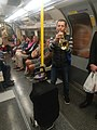 Musician performing in Piccadilly line.jpg