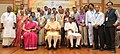 Narendra Modi in a group photograph at an informal interaction with the National Awardee Teachers, on eve of the Teachers' Day, in New Delhi. The Union Minister for Human Resource Development (5).jpg