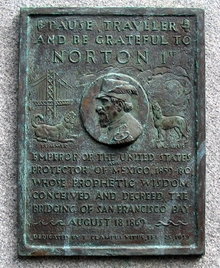 "A plaque commemorating Norton, dedicated by E Clampus Vitus on February 25, 1939, which reads ""Pause, traveler, and be grateful to Norton 1st, emperor of the United States and protector of Mexico, 1859-80, whose prophetic wisdom conceived and decreed the bridging of San Francisco Bay, August 18, 1869."" The plaque depicts Norton, flanked to the left by the Bay Bridge and a dog labeled ""Bummer"" and to the right by a dog labeled ""Lazarus""."