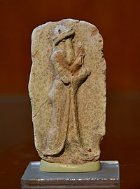 Old-Babylonian plaque showing a standing male wearing a robe-like draped dress, from Southern Mesopotamia, Iraq.jpg