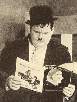 Oliver Hardy reading The New Movie.jpg