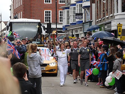 The torch relay in Newport, Isle of Wight Olympic torch relay through Newport.jpg