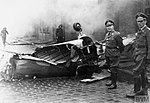 Operation WRECKAGE, Bremen - Luftwaffe officers stand by part of the wreckage of a Bristol Blenheim Mark IV.jpg