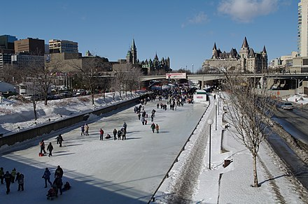 Skating on the Rideau Canal. Snow and ice is common for the region during the winter. Ottawa Rideau Canal Skating Chateau Laurier Parliament.jpg