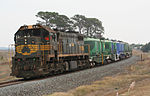 A Pacific National cement train led by Victorian X class locomotive X31 at Grovedale, Victoria, Australia, in 2007