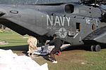 Pakistani flood victims board a U.S. Navy MH-53E Sea Dragon helicopter from Helicopter Mine Countermeasures Squadron (HM) 15, Detachment 2 during humanitarian relief efforts in Khyber-Pakhtunkhwa province 100821-M-ZG155-587.jpg